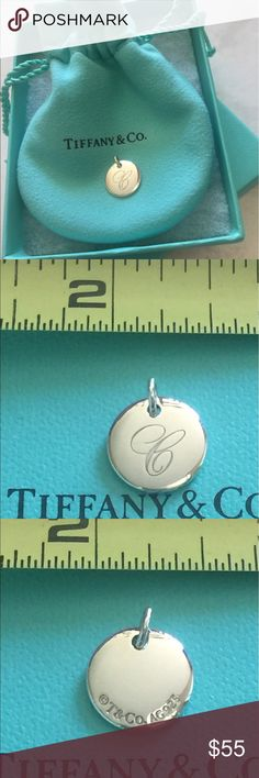 Tiffany alphabet disc charm pendant Letter C *NEW* Tiffany pendant letter C, new, with tiffany bag, pouch, box and bow! .5 inch diameter, chain not included. I purchased for friend, but before I gave it to her, I saw she had an initial pendant already. Tiffany & Co. Jewelry