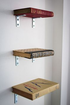 Very stylish shelving.Just fill it up with more books to hide the brackets.