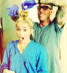 Miley Cyrus' hairdresser may have inspired her tats, AND her new do?  Find out:  http://www.popstartats.com