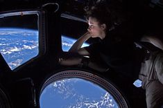 Astronaut Tracy Caldwell Dyson looks out of the space stations observation window, called the Cupola, shortly before her return to earth this October after a 176 day mission.