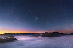 The Milky Way, Large and Small Magellanic Clouds and bright star Canopus can be seen in this image taken at sunrise over East Java's Mount Bromo