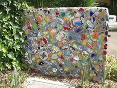 Mosaic wall in garden Mosaic Wall Art, Mosaic Diy, Diy Wall Art, Mosaic Glass, Mosaic Tiles, Stained Glass, Patio Tiles, Patio Wall, Cinder Block Walls