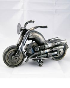 Buy an amazing Motorcycle lover art gift metal sculpture | Order an amazing motorcycle metal artworks of any model and design | Shipping worldwide  I create this motorcycles by using scrap metal parts that I find in engines, cars, industry. Therefore each motorcycle is unique! So if you order a motorcycle, it is almost impossible to be exactly the same! I try to create as identical as possible with the photo. But you should expect differences. So pick 1 in the photos and message me if you… Martial Arts Weapons, Martial Arts Styles, Metal Yard Art, Scrap Metal Art, Metal Sculpture Wall Art, Sculpture Ideas, Art Sculptures, Motorcycle Art, Metal Artwork