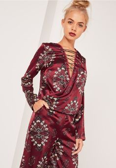 Parade the print in this babin' blouse, featuring a deep burgundy hue with an…