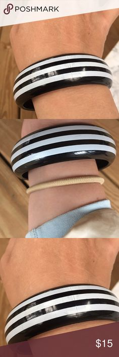 Black and White Striped Plastic Bangle Bracelet Vintage Black and White Striped Plastic Bangle Bracelet. In excellent condition. The marks you see are just reflections. Bundle and Save $$ Vintage Jewelry Bracelets