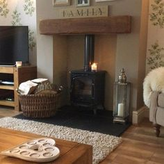 Just sat down now autumn / winter is on way changed log baskets silver one is used in summer xxx Cottage Living Rooms, Cottage Interiors, My Living Room, Living Room Decor, Log Burner Living Room, Candle Holder Decor, Front Rooms, Living Room Inspiration, Decoration
