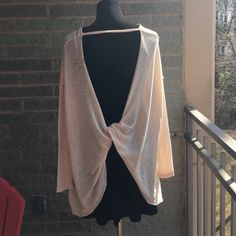 Free People Knot back sweater *see DESC about size This is so so soft!!! And runs BIG (meant to be oversized) light peach color brand new - no tags *make me an offer price not firm Free People Sweaters