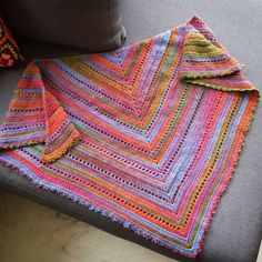 Hello,    Yesterday I finished crocheting the simple shawl...        I chose a very simple pattern for this shawl to show off this gorgeous yarn. The yarn is Scheepjes noorse sokkenwol color number 968. It is beautiful, soft, snuggly, warm, everything you wish to have in a yarn. And I