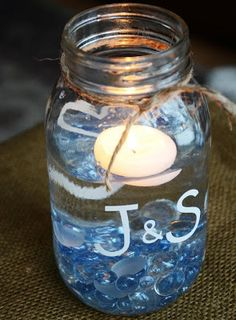 Mason Jar Centerpiece but put flowers in them