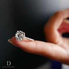 CHELSEA is a handcrafted Jean Dousset Diamonds solitaire engagement ring set in Platinum with three rows of diamonds on the band