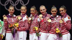 Gold medallists Anastasia Bliznyuk, Uliana Donskova, Ksenia Dudkina, Karolina Sevastyanova, Anastasia Nazarenko and Alina Makarenko of Russia celebrate during the medal ceremony for the Group All-Around Rhythmic Gymnastics