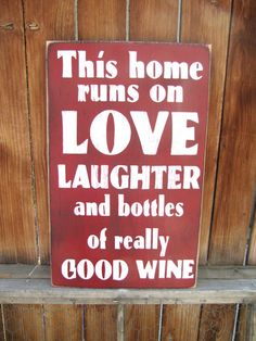 This sign is a great housewarming gift or for a bachelorette party! It says This home runs on love, laughter and bottles of really good wine.