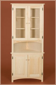 corner cabinet with raised panel glass doors - Dining Room Corner Hutch