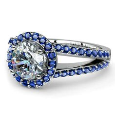 """Here's a gorgeous """"Something Blue"""" update to the regular Halo setting: The Halo Split Shank Sapphire Ring in Platinum, with a sparkling Round diamond center stone surrounded by pave-set sapphires!  http://www.brilliance.com/engagement-rings/halo-split-shank-sapphire-ring-platinum"""