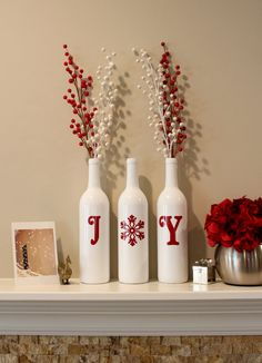 Decorate your home with some Joy! These wine bottles are spray painted white and the words are made of adhesive vinyl. ********Bottles may vary in shape from the ones pictured. **************  750ml wine bottles used. Bottles alone cost $30.00. Bottles with decorative picks $35.00 Make your selection at checkout.  ***If you would like a different color instead of red for the letters and snowflake, just request a custom order. All changes to the color of the letters will take two extra days…