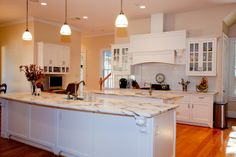 White kitchen with Calacatta Danby marble countertops