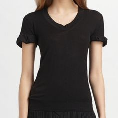 Burberry Prorsum Black Scoop neck Knit Top. L NWT Burberry Prirsum Black Scoop neck Knit Top.  Fine merino wool blend with ruffle-trimmed short sleeves.  I bought at Saks. Large NWT. Burberry Tops