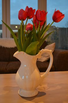 tulips in a white pitcher