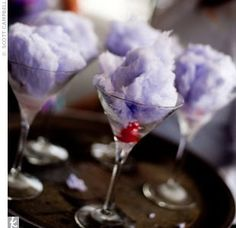 This works with sprite also.  It does not have to have alcohol in it.  Fluffy cocktail for a modern bridal shower.  We'd have blue or yellow cotton candy of course:)
