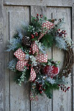 A fun and beautiful Christmas wreath decorated with pine cones and a gorgeous handmade ribbon. Place this wreath on your front door and be the envy of all your neighbors this Holiday season. Learn more by Kelea's Christmas Wreaths For Front Door, Christmas Signs Wood, Deco Mesh Wreaths, Holiday Wreaths, Pine Cone Decorations, Christmas Decorations, Holiday Decor, Handmade Christmas, Christmas Crafts