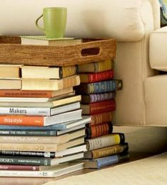 Tray side table... made out of a tray on stacks of books. Now THIS I could accomplish!