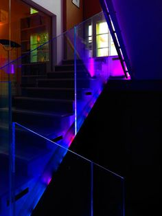 Many areas of the house feature elements that were custom-made, like in the living room, fitness room, and private study, most of which are in the designer's signature Italian style. Like these fancy LED-lit stairs, for example. Home and Studio by Iosa Ghini Assoc.