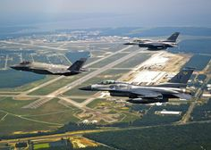 Lightning II aircraft in flight with two Fighting Falcons over Florida Poster Print Fighter Aircraft, Fighter Jets, Eglin Air Force Base, Fort Walton Beach, Air Force Bases, F 16, Aerial View, Places To See, Countryside