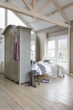 """The challenge: Create a """"bedroom"""" (well, at least a bed nook) in an open-layout studio apartment"""