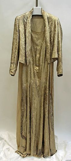 Court presentation ensemble (jacket and dress with a court train) Designer: Edward Molyneux  Date: ca. 1933 Culture: French Medium: silk, metallic thread Accession Number: 1978.161.24a, b