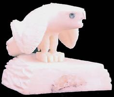 Alaskan Eskimo hawk carved from walrus tusk on a base of the same.  - Reggie Jr, DC91