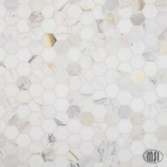 Calacata Gold Hexagon Polished - Mosaics Calacata Gold is a hexagon marble mosaic tile. White throughout with touches of bronze and grey, the hexagon comes in with a full 42 tile chip per mesh-mounted sheet. Calacatta Gold Marble, Marble Mosaic, Mosaic Wall, Mosaic Tiles, Marble Slabs, Marble Countertops, Wall Tile, Hexagon Tile Backsplash, Hex Tile