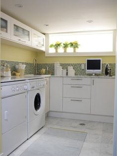 Great laundry space - this is my dream laundry room, one I can dance in!