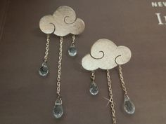 sterling silver clouds earrings with blue topaz drops. $81.00, via Etsy.