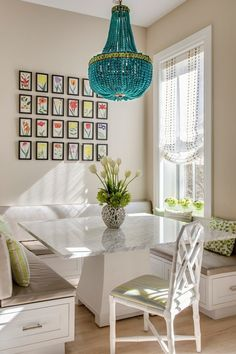 Gorgeous Turquoise Drape Chandelier adds color to the dining area