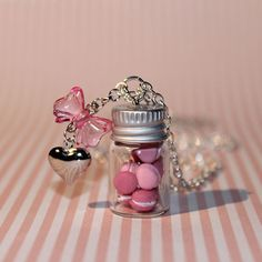 very cute bottle necklace with handmade tiny pink macaroons . its a perfect gift for someone you love (even if its yourself )it comes with a chain about
