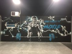 My newest painting/Mural at Eye Candi Fitness.  Spray painted this man lifting weights.