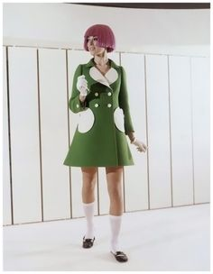 Model Green woolen coat with round pockets and white reverse was shown by the Andre Courreges fashion house During The Paris Spring and Summer showings in 1969
