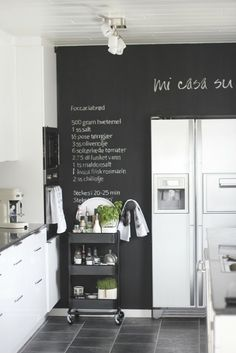 chalkboard wall in black & white kitchen | Kitchen
