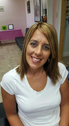 Beautiful Lowlights and Highlights on this Beautiful young lady Hair by Salon C