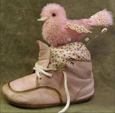 hand dyed mohair bird, czech bead eyes, vintage fabric stuffed with washed raw wool in an adorable pink baby shoe.