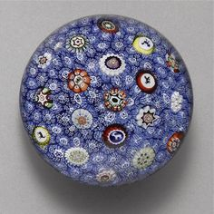 A BACCARAT SIGNED AND DATED SCATTERED MILLEFIORI BLUE CARPET GROUND WEIGHT 19TH CENTURY