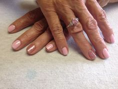 Pale pink with pink sparkle accent nail  Oasis Salon and Spa Mill Hall Pa (570)726-6565