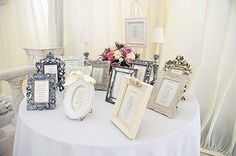Vintage and mis-matching Photoframes are used to create a really gorgeous table plan