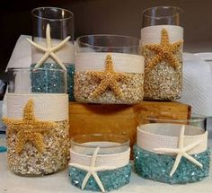 Love the sparkle of the cut glass on the outside of the candle holder and vases - Starfish and rope accents make this a charming wedding decoration for a beach wedding!