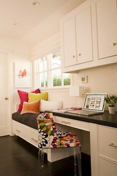 great use of space....love the window seat b/c it's a great place for kids to hang out while Mom's on the computer, vice/versa!  love the ghost chair with fun fabric