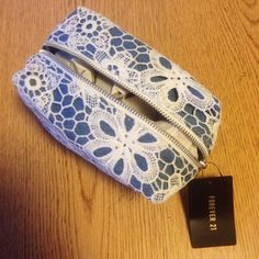 NWT cosmetic bag NEW with tags, never used!  Measures approx. 6x4x4 inches. Forever 21 Bags Cosmetic Bags & Cases