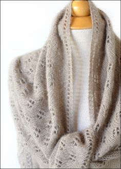 Aimee Shawl...an all-over eyelet pattern that will compliment, not overwhelm, anything it tops. Two down fibers + silk add up to ultra softness.