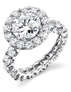 Eternity engagement ring with round diamond halo.  Timeless and stunning.