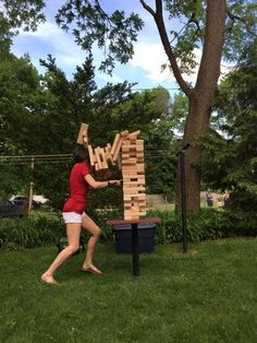 The reason you should never play giant jenga. | 23 Photos So Perfectly Timed They'll Make You Unreasonably Happy