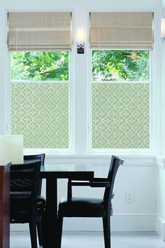 Get the best of both worlds—a little solitude and unfiltered natural light—by covering only the bottom half of a window with decorative film. | Shown: Damask Fan Window Film from @overstock